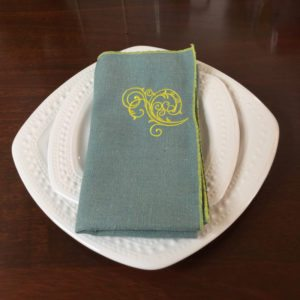 Light Aqua Napkin with Yellow Flourish