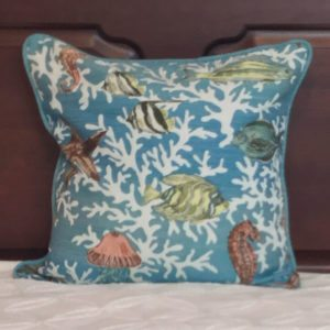 Turquoise Pillow with tropical print